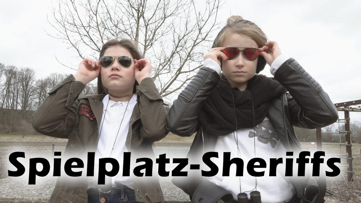 Film still - Spielplatz Sheriffs im Einsatz.